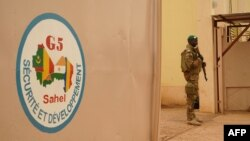 FILE - A Malian Army soldier with the G5 Sahel, an institutional framework for coordination of regional cooperation in development policies and security matters in West Africa, is seen in Sevare, May 30, 2018.