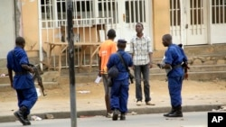 FILE - Police arrest a man in Bujumbura, Burundi, Feb. 3, 2016. Widespread rights violations and repressive measures in the country are hidden behind a façade of democracy, U.N. investigators have found.
