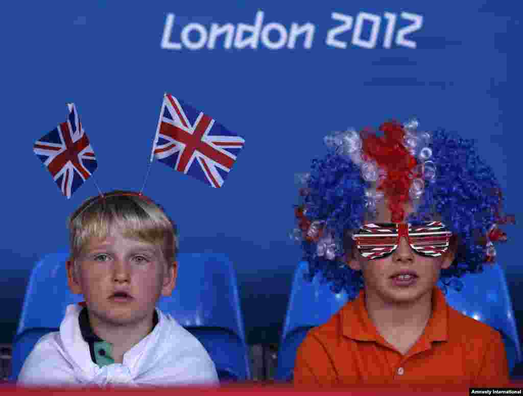 Young spectators watch the men's -81kg and women's 63kg judo competition at the London 2012 Olympic Games July 31, 2012.