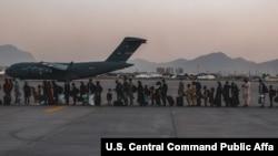 Evacuees wait to board a Boeing C-17 Globemaster III during an evacuation at Hamid Karzai International Airport, Kabul, Afghanistan, Aug. 23. (US Marine Corps photo)