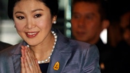FILE - Yingluck Shinawatra arrives at the Constitution court in Bangkok, May 6, 2014.
