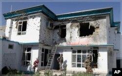 ساختمان آسیب دیده کمیشنری عالی پناهندگان ملل متحد در قندهار از اثر حمله انتحاری