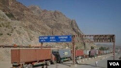 FILE - Trucks carrying containers stand idle at the closed Torkham border crossing between Pakistan and Afghanistan.