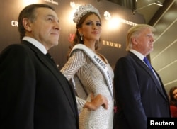 FILE - Miss Universe 2013 Gabriela Isler, Donald Trump, co-owner of the Miss Universe Organization, and businessman Aras Agalarov take part in a news conference after the Miss Universe pageant at the Crocus City Hall in Moscow Nov. 9, 2013.