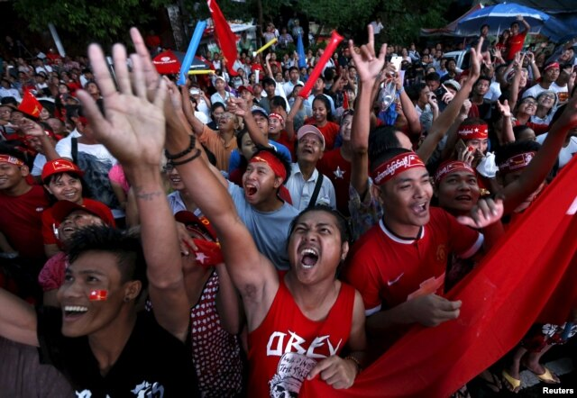 FILE - Supporters of Myanmar's pro-democracy figurehead Aung San Suu Kyi gather outside National League for Democracy headquarters (NLD) in Yangon, Myanmar, Nov. 9, 2015.