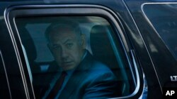 Campaign 2016 Trump: Israeli Prime Minister Benjamin Netanyahu leaves in his vehicle after a meeting with Republican presidential candidate Donald Trump at Trump Tower, Sunday, Sept. 25, 2016, in New York.