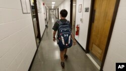 Jeremy Shuler, 12, a freshman at Cornell University, walks to meet an adviser on campus in Ithaca, New York, Aug. 26, 2016. He's the youngest student on record to attend the Ivy League school.