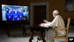 Pope Francis speaks to the crew aboard the International Space Station from the Vatican, Thursday, Oct. 26, 2017. Pope Francis' hookup Thursday marks the second papal phone call to space: Pope Benedict XVI rang the space station in 2011.(L'Osservatore Rom