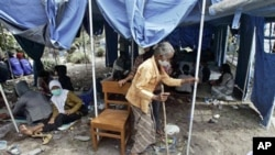 An elderly woman at a temporary shelter for people displaced by Mount Merapi eruption in Umbulharjo, Yogyakarta, Indonesia, 27 Oct 2010