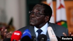 Zimbabwe's President Robert Mugabe addresses a media conference at State house in Harare, July 30, 2013.
