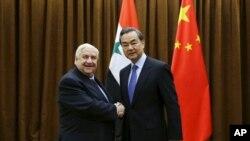 Sirijski ministar inostranih poslova Al Mualem i njegov kineski kolega Vang Ji