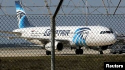A hijacked Egypt Air A320 airbus stands on the runway at Larnaca Airport in Larnaca, Cyprus , March 29, 2016. REUTERS/Yiannis Kourtoglou