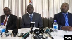 FILE: Zimbabwe's new Foreign Minister, Sibusiso Moyo (center), addresses diplomats and the media in Harare, Zimbabwe, Dec. 2017. (S. Mhofu/December 2017)