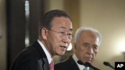 U.N. Secretary-General Ban Ki-moon addresses the media next to Israel's President Shimon Peres in Jerusalem, February 1, 2012.