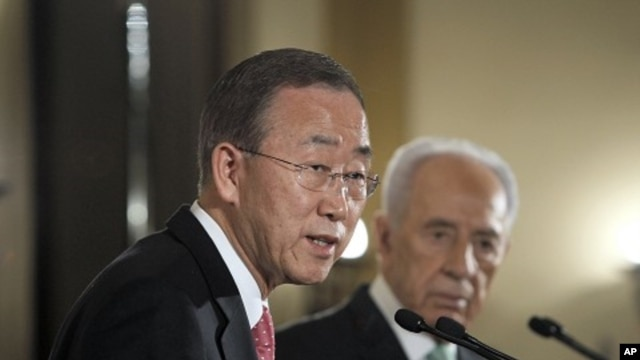 U.N. Secretary-General Ban Ki-moon addresses the media next to Israel's President Shimon Peres in Jerusalem, February 1, 2012.