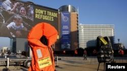 Lifejackets are pictured in front of the European Commission headquarters in Brussels during a protest by Amnesty International to demand the European Council protect the human rights of the refugees within the EU-Turkey migration deal, March 17, 2016.