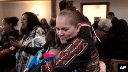 "Jessie ""Little Doe"" Baird (R) hugs a member of the audience following celebration at the Old Indian Meeting House, in Mashpee, Mass., Nov. 18, 2017. Baird and other linguists are working to reclaim the language of the Wampanoags."