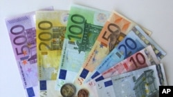 FILE - Euro currency.