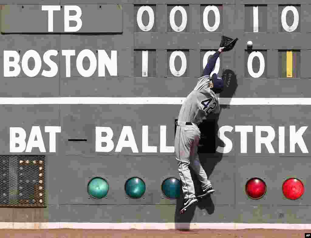 Tampa Bay Rays left fielder Matt Joyce can't get to a double off the wall by Boston Red Sox's Stephen Drew during the fifth inning of a baseball game at Fenway Park in Boston, Massachusetts.
