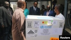 Congolese Health Ministry officials help deliver the first batch of experimental Ebola vaccines in Kinshasa, Democratic Republic of Congo, May 16, 2018.