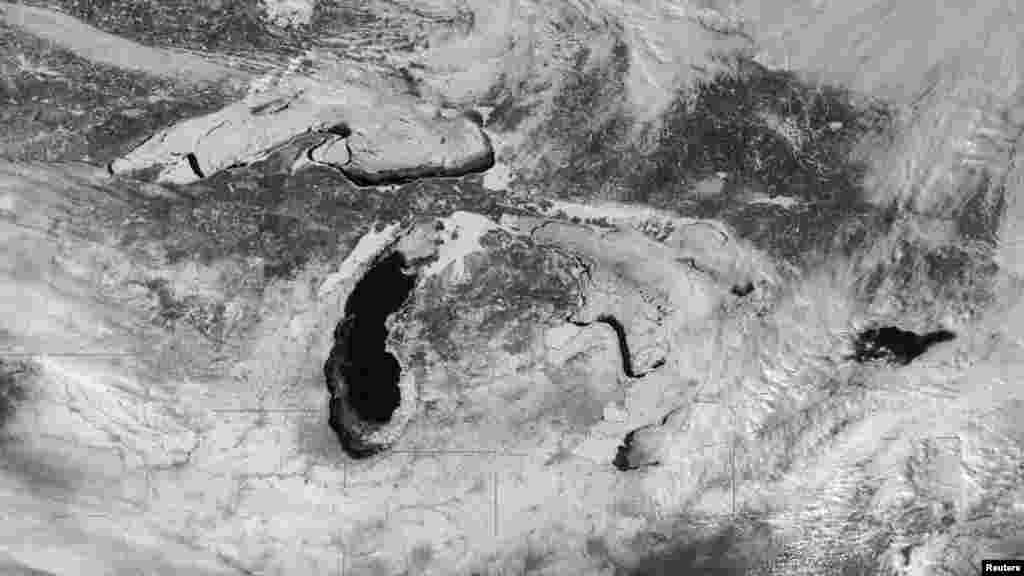 Ice cover on the Great Lakes is seen in a NASA image taken by the GOES-East satellite on Feb. 19, 2014.