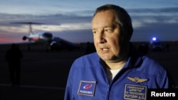 Head of the Russian space agency Roscosmos Dmitry Rogozin addresses the media upon the arrival of Russian cosmonaut Alexey Ovchinin and U.S. astronaut Nick Hague at Baikonur airport, Kazakhstan, Oct. 11, 2018.