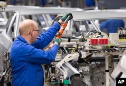 Workers complete car bodies at the plant of the German manufacturer Volkswagen AG in Zwickau, Germany, Jan. 22, 2018. President Trump vowed to tax European cars if the EU retaliates against his plans to tax imported steel and aluminum.