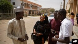 FILE - Zainab Sulaiman Umar, 26, center, a candidate for the State House of Assembly in Kumbotso constituency, Kano state, speaks to residents in Kano, northern Nigeria, Feb. 15, 2019.