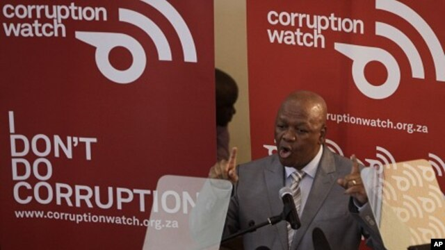 Justice Minister Jeff Radebe addresses delegates and the press attending the launch of Corruption Watch in Johannesburg, Jan. 26, 2012.