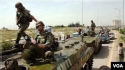 Pasukan pemerintah Suriah menyerbu ke posisi pembelot di Suriah selatan dekat perbatasan Yordania (foto: dok).