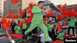 FILE - Chen Guangbiao, dressed in green respresenting is environmentalism, is seen at an event in Nanjing, Jiangsu province, Oct. 10, 2012.