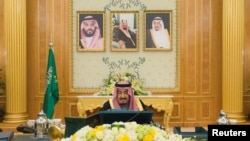 FILE - Saudi Arabia's King Salman bin Abdulaziz Al Saud presides over a cabinet meeting in Riyadh, Saudi Arabia, Dec. 12, 2017.