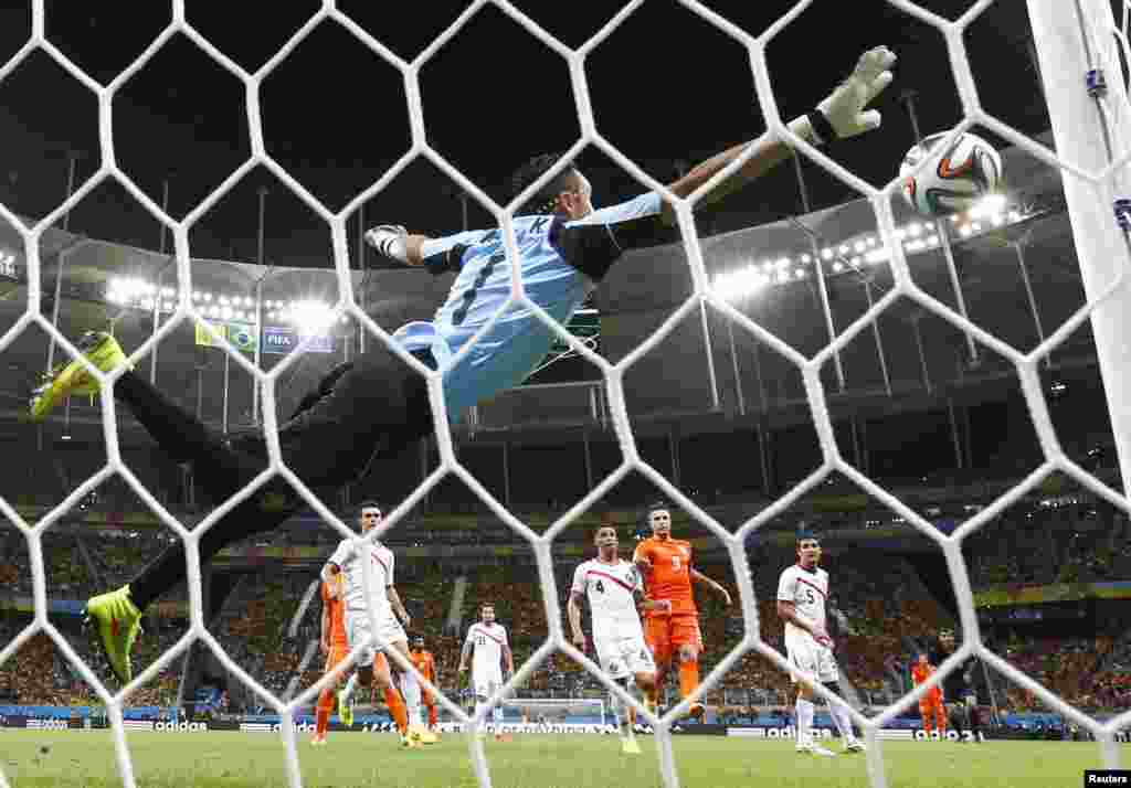 Costa Rica's goalkeeper Keilor Navas saves a free kick by Wesley Sneijder of the Netherlands at the World Cup quarter-finals at the Fonte Nova arena in Salvador, July 5, 2014