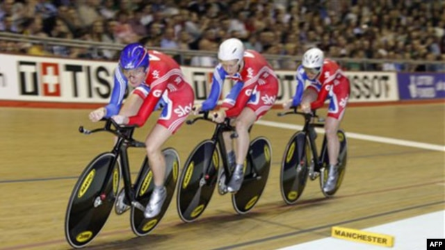 Britain's Sarah Storey, front, is a gold medal winning disabled cyclist and swimmer