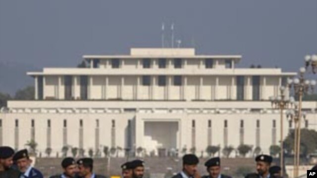 Policemen in riot gear stand guard, with parliament in the background, in Islamabad (File Photo)