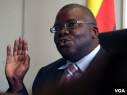 FILE - Zimbabwe's then-finance minister Tendai Biti talks at a news conference in Harare, Feb. 18, 2009.