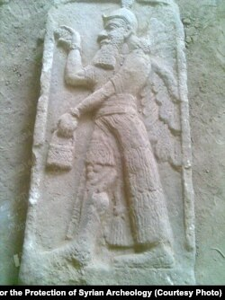 Islamic State militants previously destroyed carvings such as this Tell Ajaja bas relief from Syria as part of their campaign to purge 'idolotrous' images. (Courtesy of the Association for the Protection of Syrian Archeology)