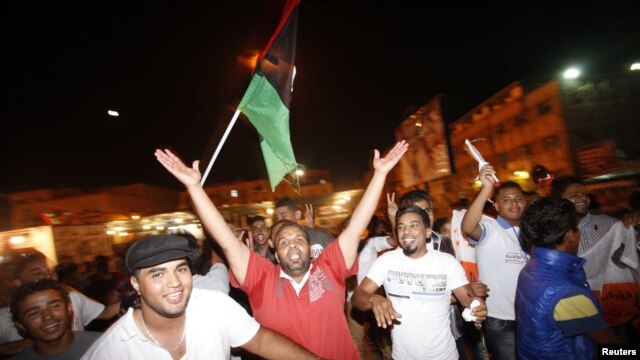People dance in the streets as they celebrate the national election in Benghazi,Libya, July 7, 2012.