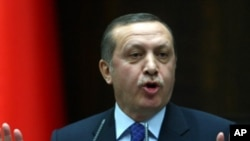 Turkey's Prime Minister Recep Tayyip Erdogan addresses lawmakers of his party at the parliament in Ankara on March 6, 2012.