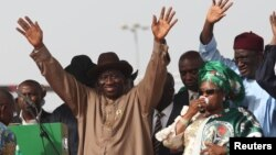 Patience Jonathan waves to supporters during a campaign rally in Abuja, March, 2011.