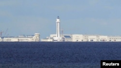 FILE - Chinese structures are pictured on the disputed Spratly Islands in the South China Sea, April 21, 2017.