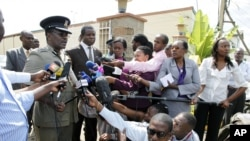 Kenyan Commissioner of Police Mathew Kirai Iteere, left, addresses media on the weekend attack on the police officers in Samburu, northwestern Kenya at Wilson Airport in Nairobi, Nov. 13, 2012.