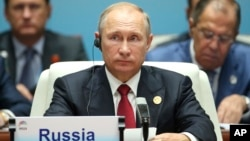 Presiden Rusia Vladimir Putin pada KTT negara-negara BRICS di Xiamen, China, Selasa (5/9).