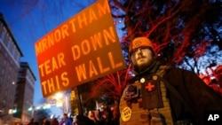 A demonstrator stands on the sidewalk before a pro gun rally, Jan. 20, 2020, in Richmond, Va.