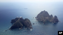 FILE - Islands called Dokdo in Korea and Takeshima in Japan