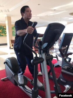 Hun Sen works out on a treadmill.