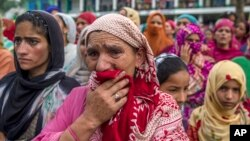 Kashmiri women grieve as they watch funeral of Showkat Ahmed Lohar, a local militant in Arwani, about 55 kilometesr (35 miles) south of Srinagar, India, July 18, 2017. Indian soldiers and police killed three suspected rebels during a brief gun battle Mond