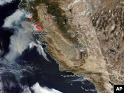 This Oct. 9, 2017, satellite image from the National Oceanic and Atmospheric Administration shows smoke from several fires, noted in red, burning in California, with winds generally blowing from east to west. From the top are the Tubbs and other fires in the Santa Rosa and Napa Valley wine country north of the San Francisco Bay area, top left, several smaller fires in the Sierra Nevada, right center to lower right, and the Canyon 2 fire in Orange County east of Los Angeles, bottom.