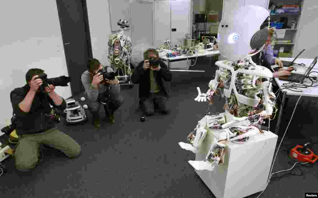 Photographers take pictures of the humanoid robot ROBOY during a media presentation at the Artificial Lab of the University of Zurich in Zurich, Switzerland.