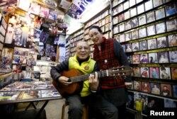 Kazuhiko Kobayashi, 80, and his wife, Mieko Kobayashi, 73, at their music shop named Ameyoko Rhythm, specialized for Enka, traditional Japanese popular ballad, in Tokyo's Ameyoko shopping district, Japan, Feb. 8, 2018.